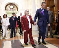 "Rep. Rafael Anchia, D-Dallas (right) escorts Amparo Camacho, grandmother of 12-year-old Linda ""Michellita"" Rogers, and the rest of the family in attendance (background) to his House of Representatives office at the Texas State Capitol in Austin, Wednesday, February 27, 2019. Michellita''s mother Linda Rogers (left) and father Jose Fiscal joined them. Michellita died when their home exploded following a natural gas leak a year ago. (Tom Fox/Staff Photographer)"