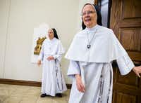 Sister Joseph Andrew Bogdanowicz (right) and Mother Assumpta Long, both foundresses of the Dominican Sisters of Mary, Mother of the Eucharist, walk into a temporary chapel inside a new convent in Georgetown, Texas, on Feb. 18, 2019. Both women are from Ann Arbor, Mich., but traveled to Texas to speak to the media at the new convent location. (Ashley Landis/Staff Photographer)