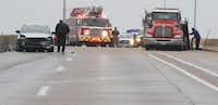 Dallas Police officers work an accident on southbound U.S. Highway 67 over Hampton Road on Thursday in Dallas.(Irwin Thompson/Staff Photographer)