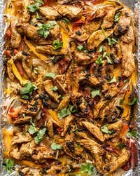 """Hot"" Chicken Sheet Pan Fajitas are marinated in hot sauce, cilantro and orange juice.(Rebecca White/Special Contributor)"