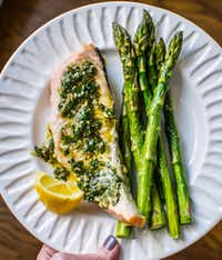 Sheet Pan Salmon and Asparagus with Chimichurri is an easy yet elegant weeknight meal.(Rebecca White/Special Contributor)