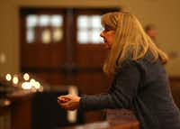 The Rev. Laura Echols-Richter prays in the sanctuary at Grace Avenue United Methodist Church in Frisco.(Rose Baca/Staff Photographer)