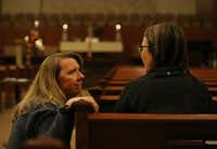 The Rev. Laura Echols-Richter (left) speaks with church member Tina McGarry in the sanctuary at Grace Avenue United Methodist Church in Frisco. The Frisco church opened its doors to prayers after the denomination's anti-LGBTQ vote in St. Louis on Tuesday.(Rose Baca/Staff Photographer)