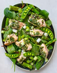 Sheet Pan Salmon and Asparagus with Chimichurri can be turned into a salad with green onions and snap peas.(Rebecca White/Special Contributor)
