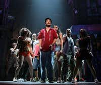 This Feb. 29, 2008 picture shows Lin-Manuel Miranda, center, and members of the cast in a scene from the musical <i>In the Heights</i>, playing at Broadway's Richard Rodgers Theatre in New York. (Joan Marcus/AP)