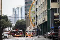 Emergency vehicles are parked outside of Zenna Thai & Japanese Restaurant after firefighters put out a fire that started in the kitchen on Thursday, February 28, 2019 in downtown Dallas.(Ashley Landis/Staff Photographer)