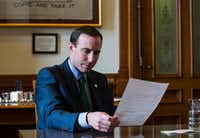 <p>Interim Secretary of State Whitley looks at a voter registration application handed to him by a reporter. Despite Democratic senators' statements that they oppose confirming him as Texas' top election official, Republican Gov. Greg Abbott is fighting hard to win at least two Democrats' cooperation.</p>(Ashley Landis/Staff Photographer)