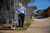 In 2017, a Dallas city garbage truck turning in the alley behind his house hit Ralph VanDuzee's gas meter, causing a hissing leak. Atmos Energy fixed it, but VanDuzee said the meter is now in a more vulnerable position, facing the alley. He said he's still waiting for Atmos to put a protective barrier around the meter. (Tom Fox/Staff Photographer)