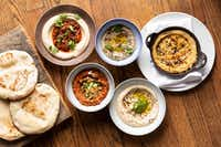 At Chris Shepherd's One Fifth Mediterranean, a popular order is I Dip, You Dip, We Dip: Top L to R: Hummus with ground lamb; Mutabal (eggplant dip); Turkish hummus Bottom L to R: Muhamara (roasted red pepper and walnut spread); hummus with green tehina.(Julie Soefer Photography)
