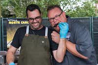 Aaron Franklin, a Southern Smoke participant since the inaugural festival, feeds Chris Shepherd brisket at the 2018 festival. Southern Smoke 2018 raises over $425,000 for charity at its 3rd annual event in Houston on Sept. 30, 2018.(Michelle Watson/CatchLight)