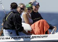 Then-President George W. Bush, his daughter Jenna Bush and former President George H.W. Bush went fishing off Boon Island near Kennebunkport, Maine, on Aug. 8, 2004.(File Photo/The Associated Press)
