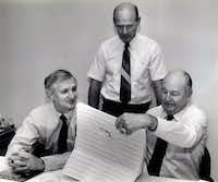 Shot April 29, 1986 - Dallas Cowboys officials Gil Brandt (from left), Tom Landry and Tex Schramm look over their choices for the second round draft picks in a conference room at Valley Ranch.(David Woo/3092)