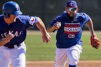 Texas Rangers second baseman Rougned Odor chases down minor-leaguer Alex Kowalczyk during a fielding drill on Feb. 19 at the team's spring training facility in Surprise, Ariz.(Smiley N. Pool/Staff Photographer)