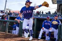 Texas Rangers infielder Patrick Wisdom takes the field for a spring training game against the Milwaukee Brewers on Feb. 24 at Surprise Stadium in Surprise, Ariz.(Smiley N. Pool/Staff Photographer)