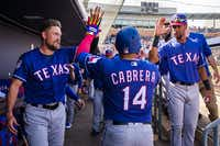 "<p>Rangers third baseman Asdr<span style=""font-size: 1em; background-color: transparent;"">ú</span><span style=""font-size: 1em; background-color: transparent;"">bal Cabrera gets high-fives from outfielders Hunter Pence (left) and Leody Taveras as he comes out during the fourth inning of a spring training game against the Seattle Mariners on Feb. 26 in Peoria, Ariz.</span></p>(Smiley N. Pool/Staff Photographer)"