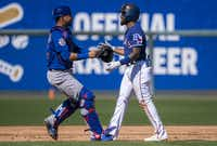 "<p>Rangers outfielder Delino DeShields waits with a smile and a hug to be tagged out by Chicago Cubs catcher Willson Contreras <span style=""font-size: 1em; background-color: transparent;"">during a spring training game on Feb. 27 in Surprise, Ariz. DeShields had gotten </span><span style=""font-size: 1em; background-color: transparent;"">caught in a rundown between second and third after smacking a two-RBI double.</span></p>(Smiley N. Pool/Staff Photographer)"