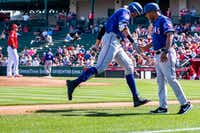 "<p>Rangers first baseman Ronald Guzman slaps hands with third base coach Tony Beasley as he rounds the bases following a solo home run <span style=""font-size: 1em; background-color: transparent;"">off of Los Angeles Angels pitcher Tyler Skaggs (left) —</span><span style=""font-size: 1em; background-color: transparent;""> his first of two on the day — during the second inning of a spring training game on  Feb. 28 in Tempe, Ariz.</span></p>(Smiley N. Pool/Staff Photographer)"