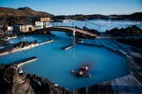 Even if you don't see the northern lights, you can still float in the Blue Lagoon, a geothermal spa that is one of the most-visited attractions in Iceland.(Jabin Botsford/The Washington Post)