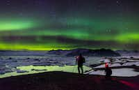 "<p>Photographers try to capture the brilliant color of the northern lights at the&nbsp;<span style=""font-size: 1em; background-color: transparent;"">Jökulsárlón&nbsp;</span><span style=""font-size: 1em; background-color: transparent;"">glacial lagoon in southeastern Iceland.&nbsp;</span></p>(Promote Iceland)"
