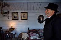 Stevens Nelson, the director of the Provo Pioneer Village, gives a tour of the open-air historical attraction. (Evan Cobb/The Washington Post)