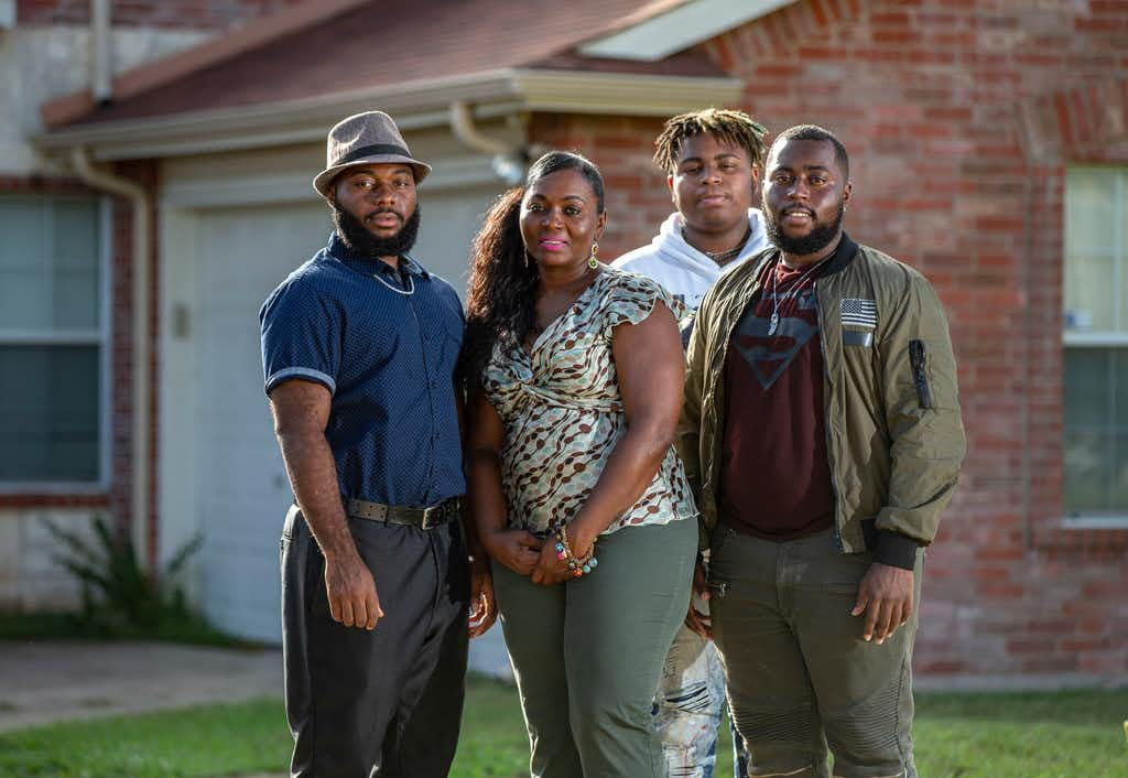 Sammie Anderson with her sons: Sam Bible, left; Tyrone Anderson, third from left; and Grant Bible. Not shown: Matt Bateman.(Brandon Wade/Special Contributor)