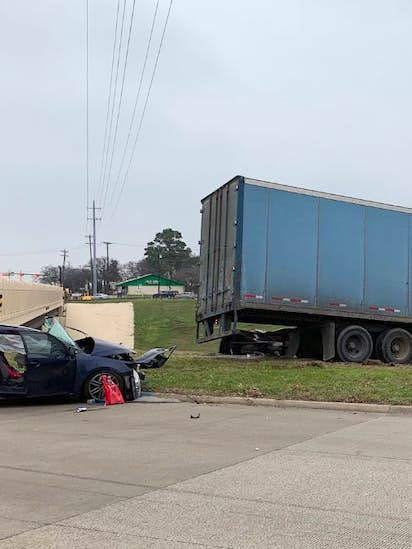 Red-light runner hospitalized after crash with 18-wheeler in