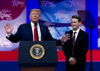 President Donald Trump invites to speak in the podium to Hayden Williams, a field representative of the Leadership Institute who was assaulted at a University of California at Berkeley campus event, at the Conservative Political Action Conference.(Jose Luis Magana/AP)