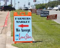 Signs along Garland Road points the way to the White Rock Farmers Market.(Ron Baselice/Staff Photographer)
