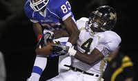 """<p><span style=""""font-size: 1em; background-color: transparent;"""">Duncanville receiver Jeff Thomas (83) wrestles the ball from Mansfield's Damon Bullock (4).</span></p>(2010 File Photo/Tom Fox)"""