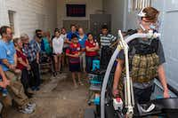 Joel Booth, an undergraduate research assistant, demonstrates a breathing task during Science in the City at Southern Methodist University in Dallas in 2018. The machine was measuring the difference between the inspired and expired air to calculate his energy expenditure.(Carly Geraci/Staff Photographer)
