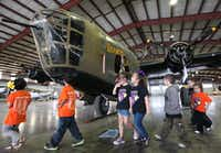 """<p><span style=""""font-size: 1em; background-color: transparent;"""">Elementary students from Crane marveled at """"Diamond Lil,"""" one of only two B-24 planes that still fly, during a tour at the Commemorative Air Force Museum in Midland. Dallas Executive Airport will be the plane's new home base.</span></p>(Odessa American/Ryan Evon)"""