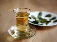 Moringa leaves grown in Ethiopia are steeped for tea at Rakkasan Tea Company in Dallas. (Rose Baca/Staff Photographer)