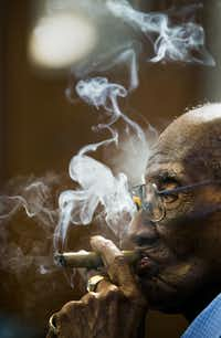 U.S. Army veteran Richard Overton, 111, smokes a cigar at 6:41 a.m. on May 5, 2018 at his home in Austin, Texas. Mr. Overton, who is a local celebrity, rises some time between 3 and 5 a.m. and smokes about 15 cigars a day.(Ashley Landis/Staff Photographer)