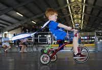 Little Mister Schulenburg Clay Hoffman, 4, participates in the tricycle races during the 2018 Schulenburg Festival on August 4, 2018 at Walters Park in Schulengburg, Texas. (Ashley Landis/Staff Photographer)