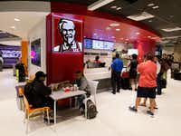 Customers lined up at a Kentucky Fried Chicken restaurant inside Miami International Airport in Miami in 2016. The company's shareholders helped persuade it to switch to antibiotic-free chicken.(Wilfredo Lee/The Associated Press)