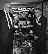 This 1997 photo shows Jack Kilby and Jerry Merryman, right, at the American Computer Museum in Bozeman, Montana. Kilby, Merryman and James Van Tassel are credited with having invented the handheld calculator while working at Dallas-based Texas Instruments. (Phyllis Merryman/AP)