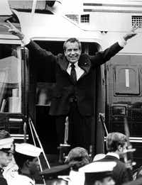 Richard Nixon waves goodbye with a salute to his staff members outside the White House as he boards a helicopter and e resigns the presidency on Aug. 9, 1974. He was the first president in American history to resign the nation's highest office.(AP)
