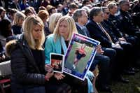 People who lost loved ones in crimes linked to  immigration listen while President Donald Trump speaks about a state of emergency for a border wall from the Rose Garden of the White House Feb. 15, 2019 in Washington, D.C.(Brendan Smialowski/AFP/Getty Images)