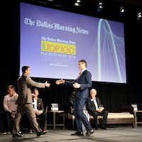 Grant Moise (right), president and publisher of <i>The Dallas Morning News</i>, shook hands with Josh Harley, CEO of Fathom Realty, the No. 1 large company, during the 2018 <i>Dallas Morning News</i> Top 100 luncheon at the Omni Dallas Hotel.(Smiley N. Pool/Staff Photographer)
