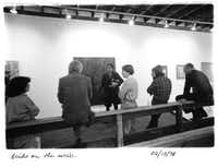 A group of gallery members leans and sits against a railing inside 500X Gallery in 1978, the year the gallery opened.(500X Gallery)