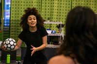 Lauren Steele practices her soccer skills with Elena Urdaneta during a rehearsal for <i>The Wolves.</i>(Shaban Athuman/Staff Photographer)