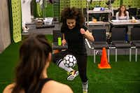 Lauren Steele practices soccer skills with Sydney Lo during a rehearsal for a production of <i>The Wolves</i> at Wyly Theatre in Dallas on Feb. 22, 2019.&nbsp;(Shaban Athuman/Staff Photographer)
