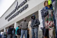 People line up at outside of the entrance at the Texas Department of Public Safety Driver License in Garland, Texas on Friday, March 1, 2019. (Shaban Athuman/Staff Photographer)