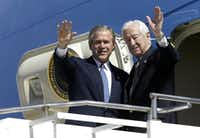 President George W. Bush and then-Rep. Ralph Hall waved as they arrive on Air Force One at Love Field in Dallas on March 8, 2004. Hall died on Thursday at age 95.(File 2004/Agence France-Presse)
