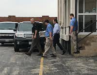 Mark Jordan (second from right) left the Sherman federal courthouse in handcuffs and shackles after being found guilty in March. He was later released from custody.(Kevin Krause/Staff)