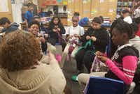 <p>Some of Charlotte Geisler's fifth-grade students at Wilmer-Hutchins Elementary School work on their crochet creations. Geisler often invites the students to spend a portion of their recess learning how to crochet. Once a month, Geisler collects their work and donates it to local homeless shelters. </p>(Charlotte Geisler)