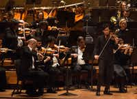 Led by guest conductor Juraj Valcuha, violin soloist Stefan Jackiw performs with the Dallas Symphony Orchestra at the Meyerson Symphony Center on Thursday.(Ryan Michalesko/Staff Photographer)