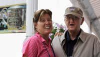 Dan Jenkins poses for a photo with his daughter, longtime <i>Washington Post</i> sportswriter and columnist Sally Jenkins, in August 2009 at the PGA Championship at Hazeltine National Golf Club in Chaska, Minn. Jenkins died Thursday at 90.(2009 File Photo/The Associated Press)