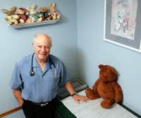Dallas pediatrician Albert Karam has long had a policy at his practice against accepting unvaccinated patients.(Vernon Bryant/Staff Photographer)