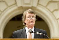 University of Texas President Bill Powers spoke to the media on July 15, 2014, on the south steps of the Main Tower in Austin. (Laura Skelding/The Associated Press)